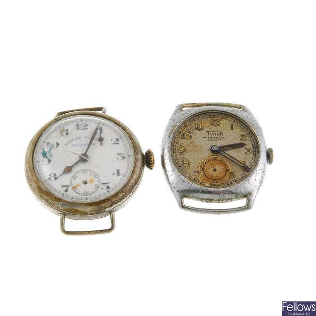 A Tudor watch head with a West End Watch Co. watch head.