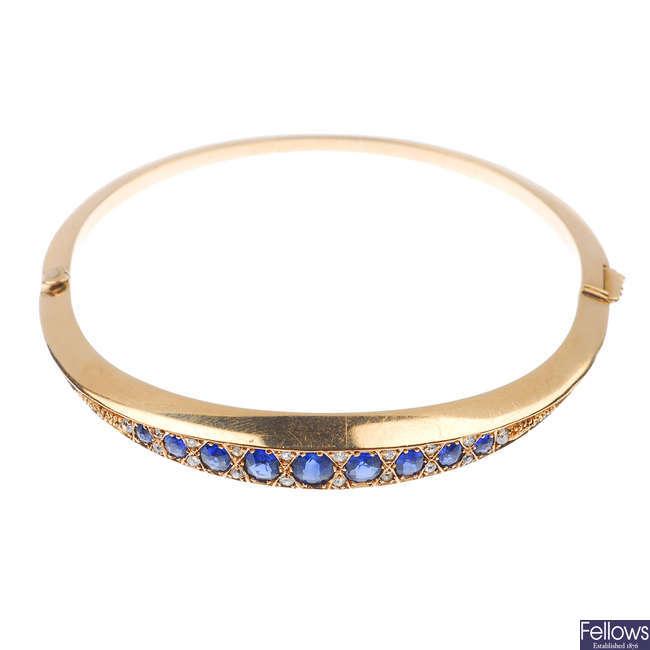 An early 20th century sapphire and diamond hinged bangle.