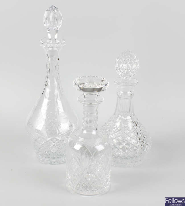 A group of glass decanters and candlesticks