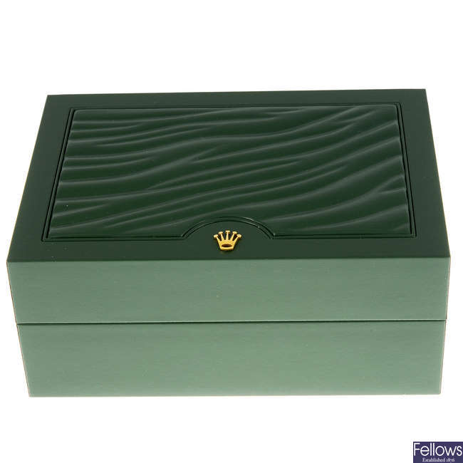 An incomplete Rolex watch box.
