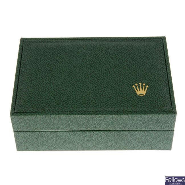 A complete Rolex watch box.