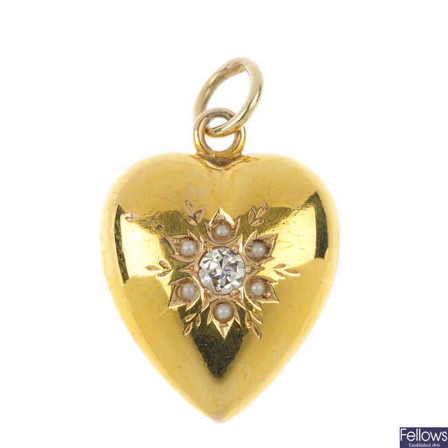 A late Victorian 15ct gold seed pearl and diamond heart pendant.