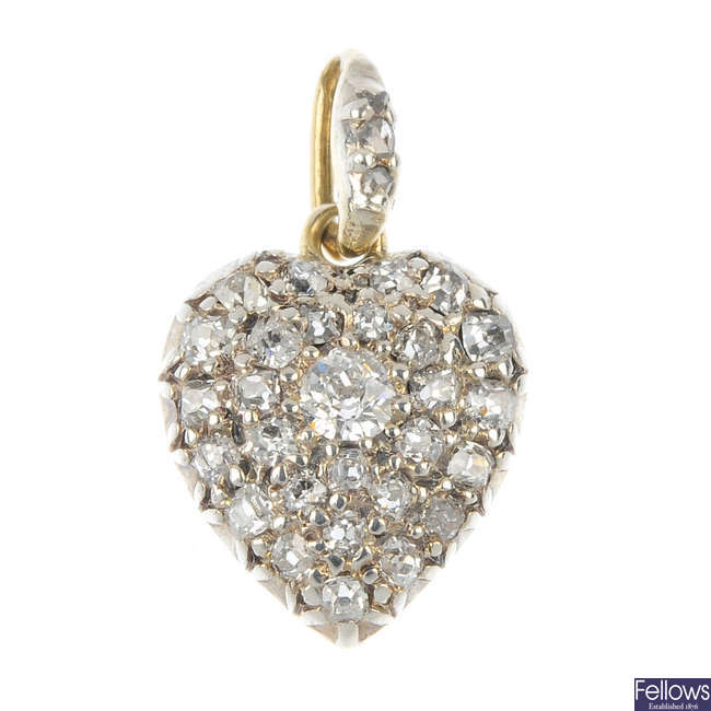 A late 19th century silver and gold diamond heart pendant.