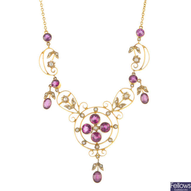 An early 20th century 9ct gold garnet and split pearl necklace.