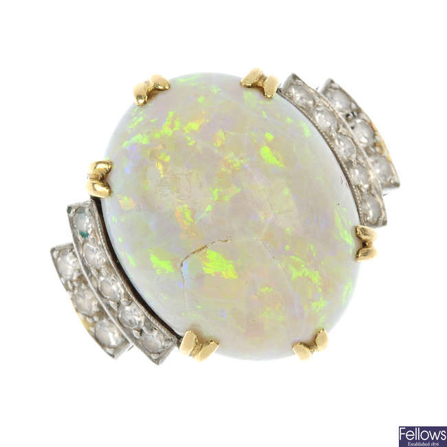 A mid 20th century gold opal and diamond dress ring.
