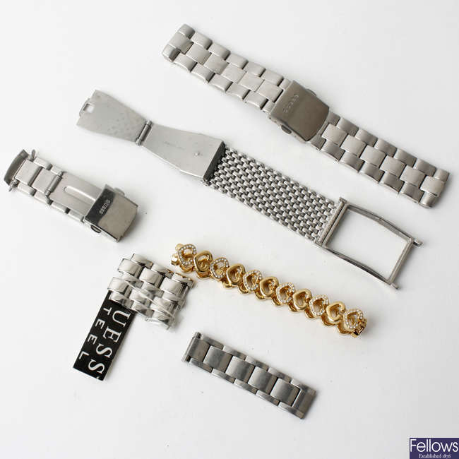 A bag of various watch links and parts.