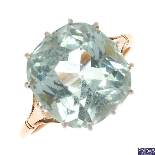 An aquamarine single-stone ring and a paste bar brooch.
