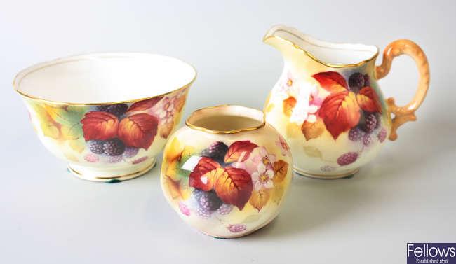 A Royal Worcester bone china vase of squat form