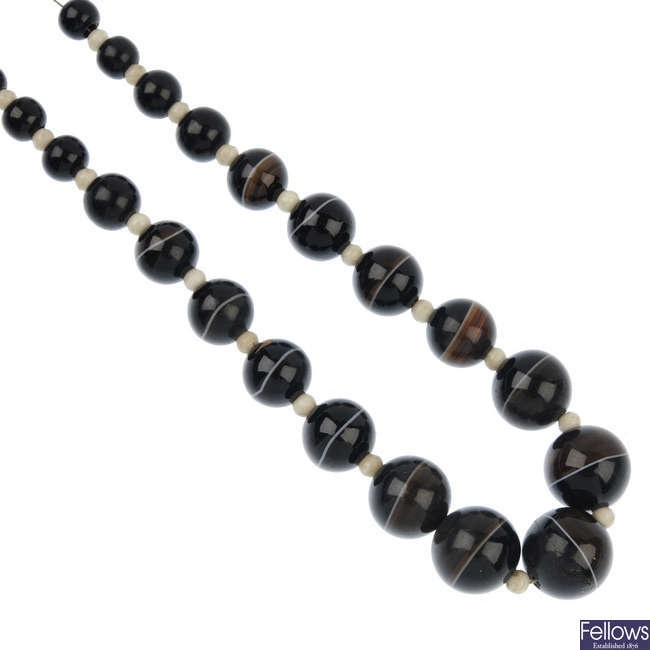 An agate, jet and paste bead necklace.