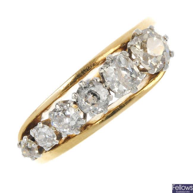 A diamond six-stone ring.