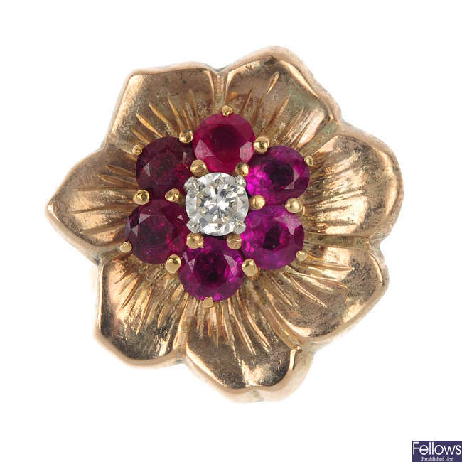 A diamond and ruby floral ring.
