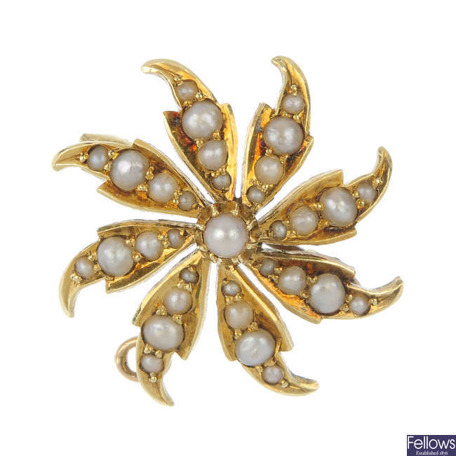 An early 20th century 15ct gold split pearl star brooch.