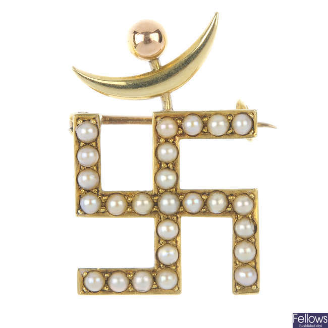An early 20th century 15ct gold seed pearl Swastika and crescent moon brooch.