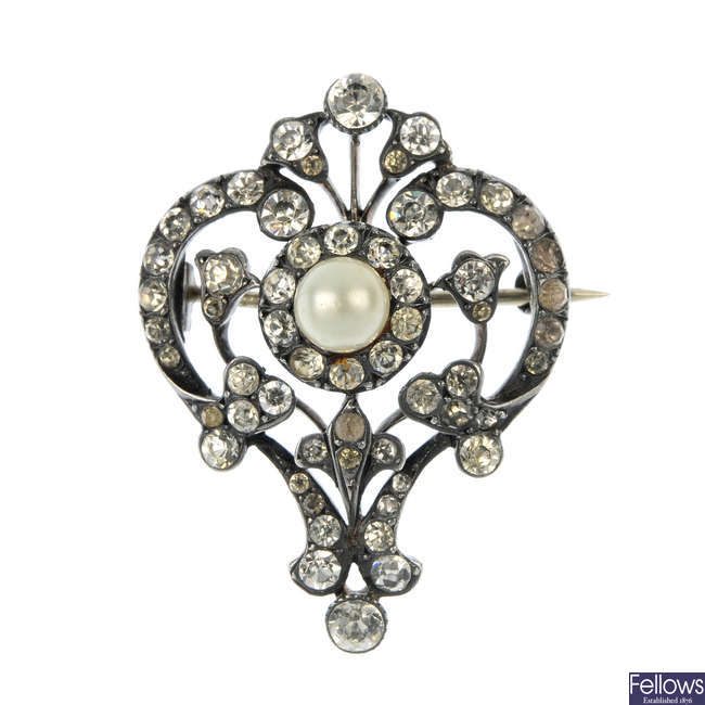 An early 20th century silver paste and imitation pearl brooch.