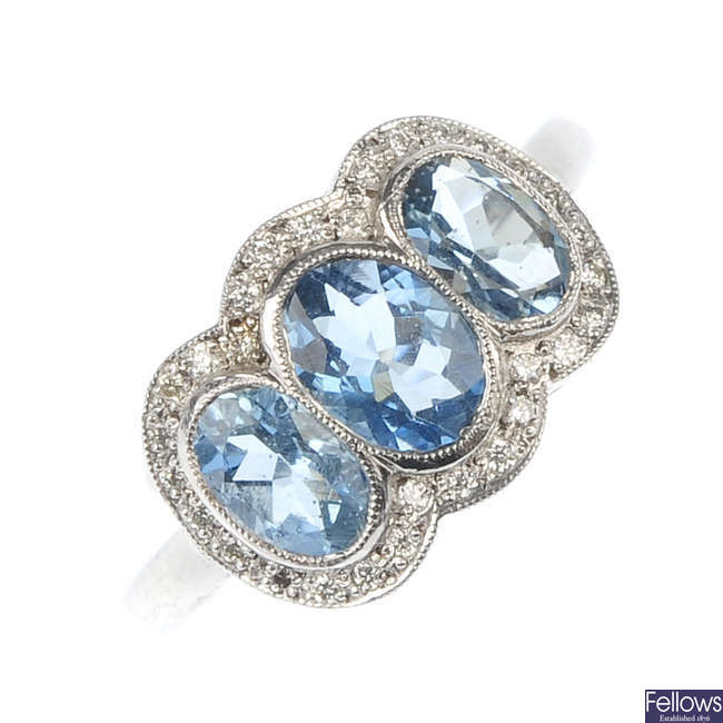 An aquamarine and diamond triple cluster ring.