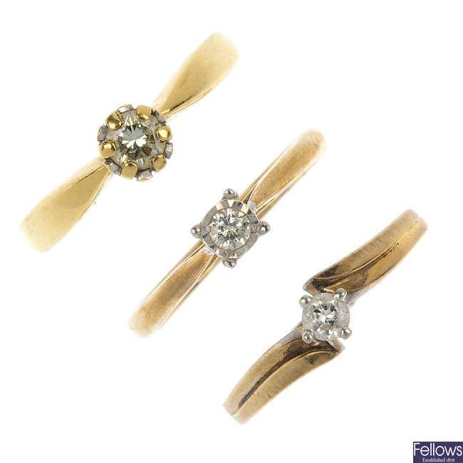 A selection of nine gold gem-set rings.