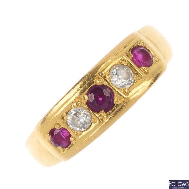 An early 20th century 22ct gold ruby and diamond five-stone ring.