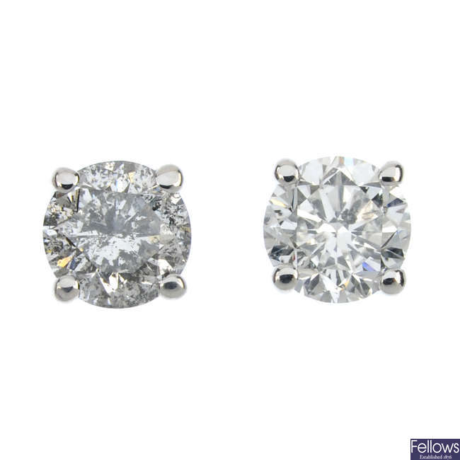 A pair of 9ct gold brilliant-cut diamond single-stone ear studs.