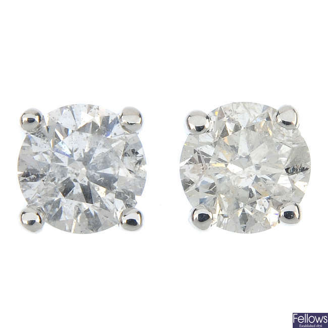 A pair of 9ct gold brilliant-cut diamond and laser-drilled diamond single-stone ear studs.