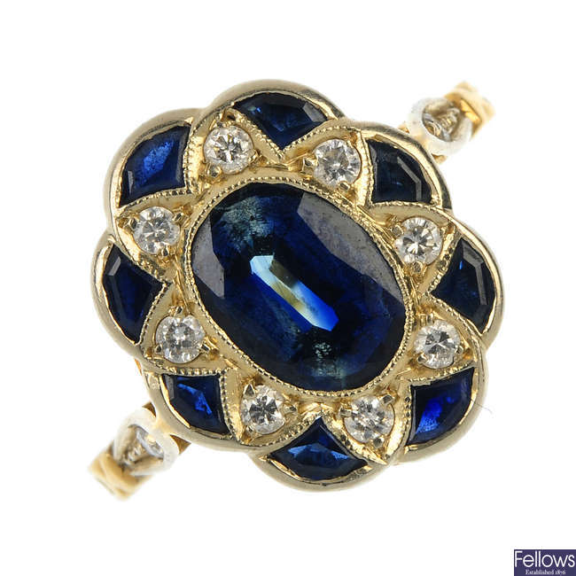 A sapphire and diamond panel ring.