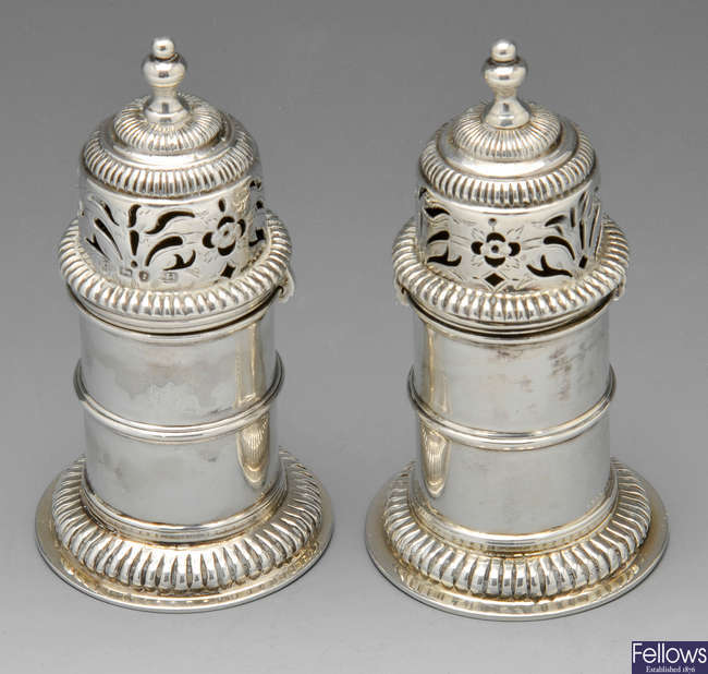 A pair of Victorian silver peppers.