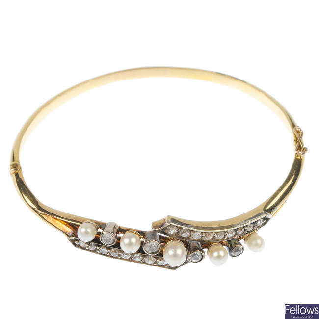 An early 20th century 18ct gold and silver diamond and cultured pearl bangle.