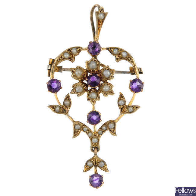 An early 20th century 9ct gold gem-set pendant and ear pendants.
