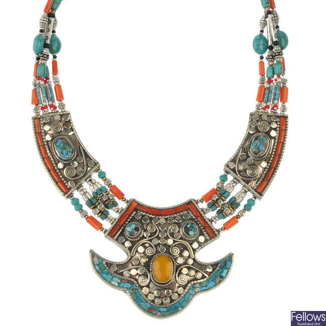 A gem-set necklace and two bangles.