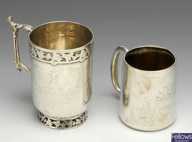 A Victorian silver christening mug & a later example.