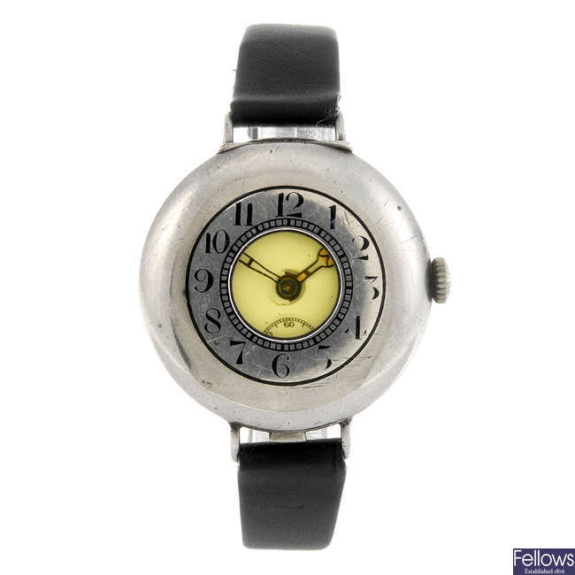 A trench style wrist watch.