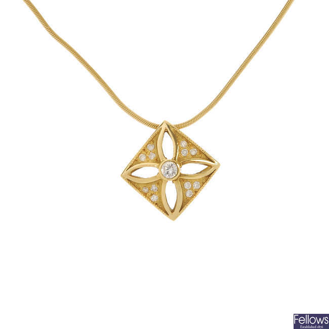 An 18ct gold diamond pendant.