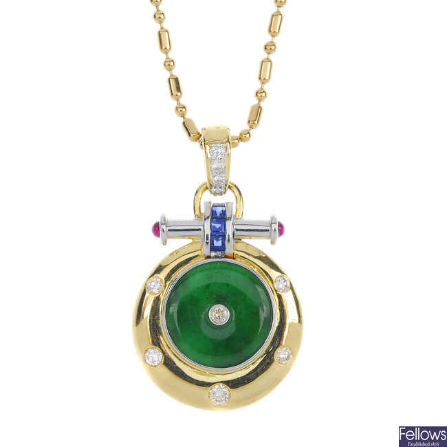 A jade, sapphire, ruby, and diamond pendant with chain.