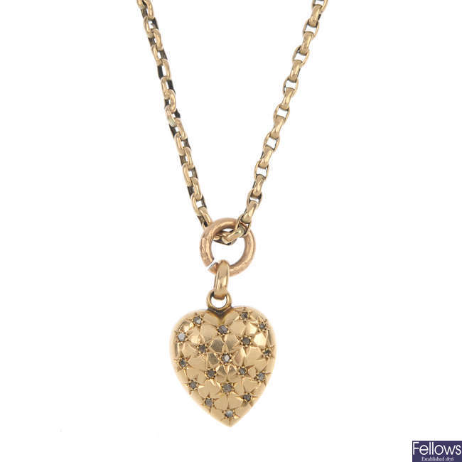 An early 20th century 15ct gold diamond pendant.