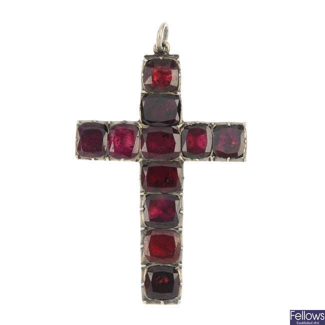 A mid 19th century foil-back garnet cross pendant.