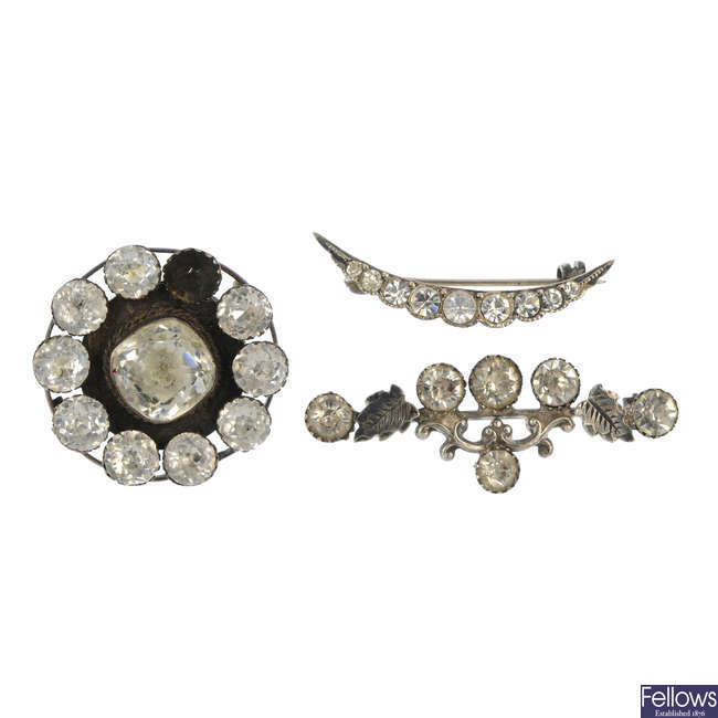 A selection of seven early 20th century items of paste jewellery.