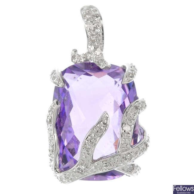 An amethyst and diamond pendant.