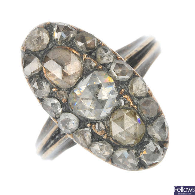 A mid 19th century 10ct gold and silver diamond panel ring.