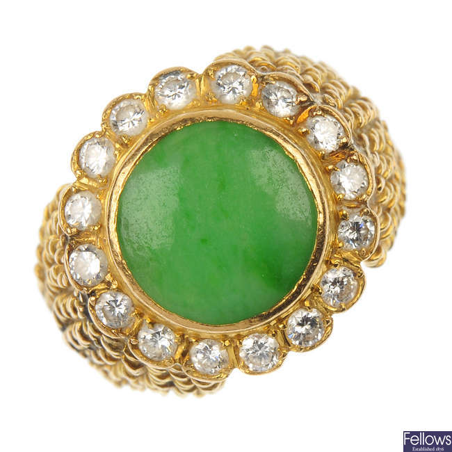 A mid 20th century gold jade and diamond cluster ring.