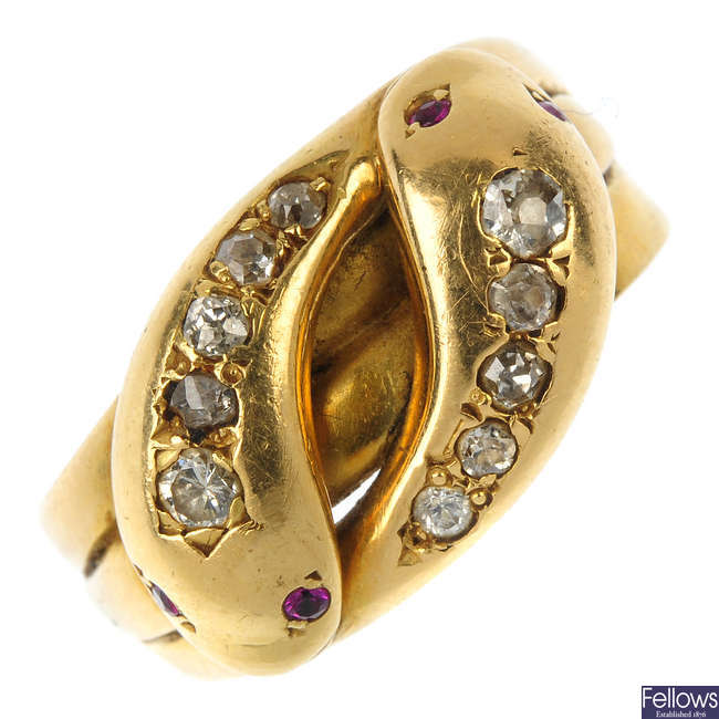 An early 20th century 18ct gold diamond and ruby snake ring.