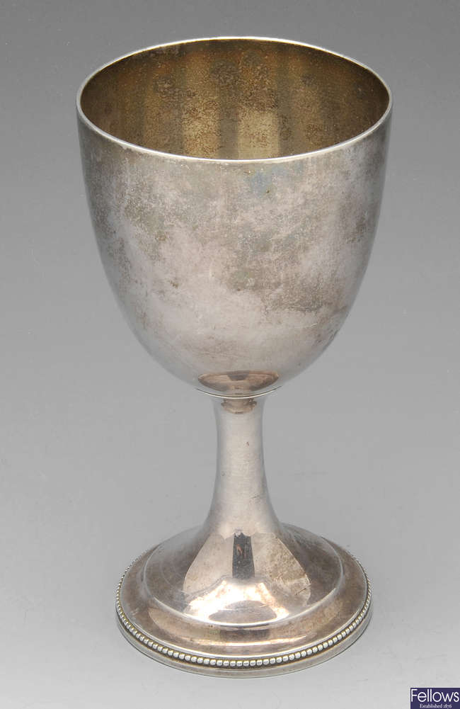 A Victorian silver goblet.