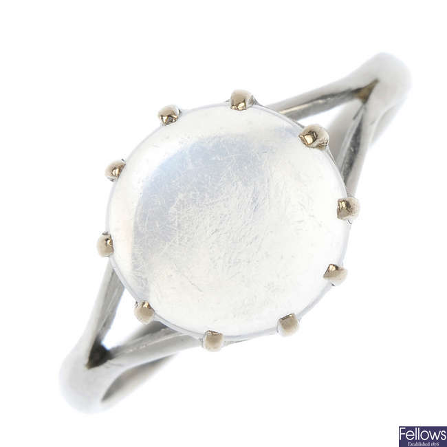 An early 20th century platinum moonstone single-stone ring.