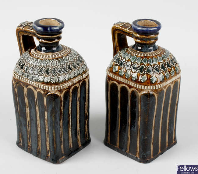 A pair of late Victorian Doulton Lambeth stoneware decanter bottles