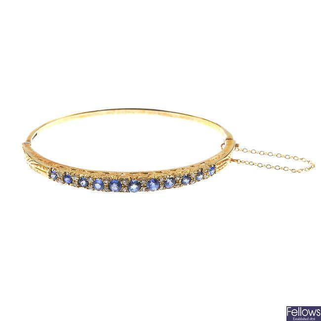 A 9ct gold sapphire and diamond hinged bangle.