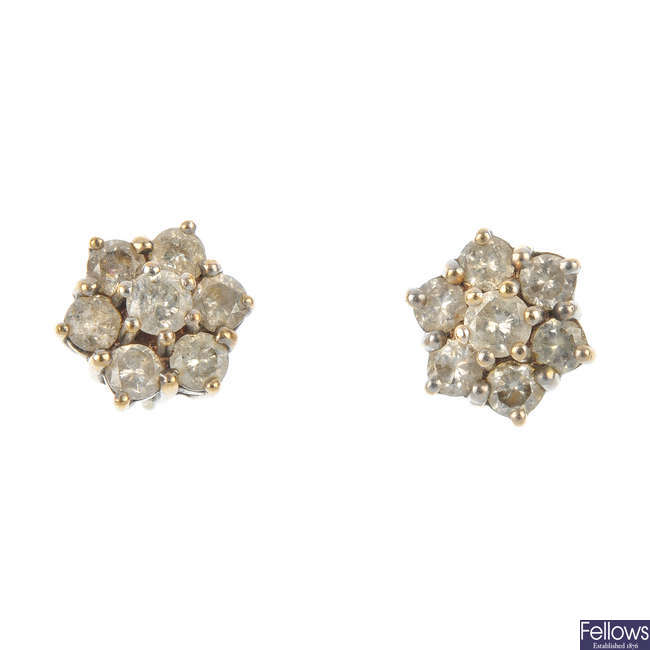 A pair of diamond cluster ear studs.