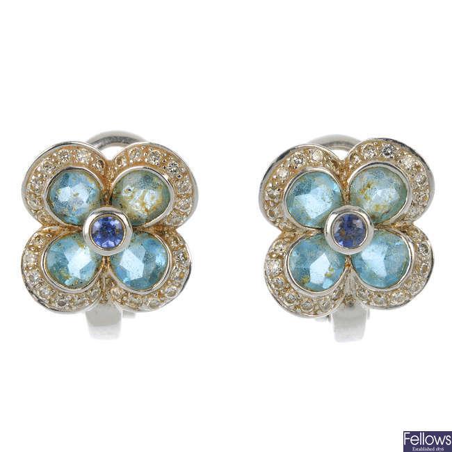 A pair of diamond, sapphire and topaz ear studs.