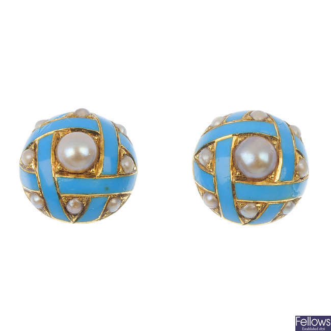 A pair of late 19th century split pearl and enamel ear studs.