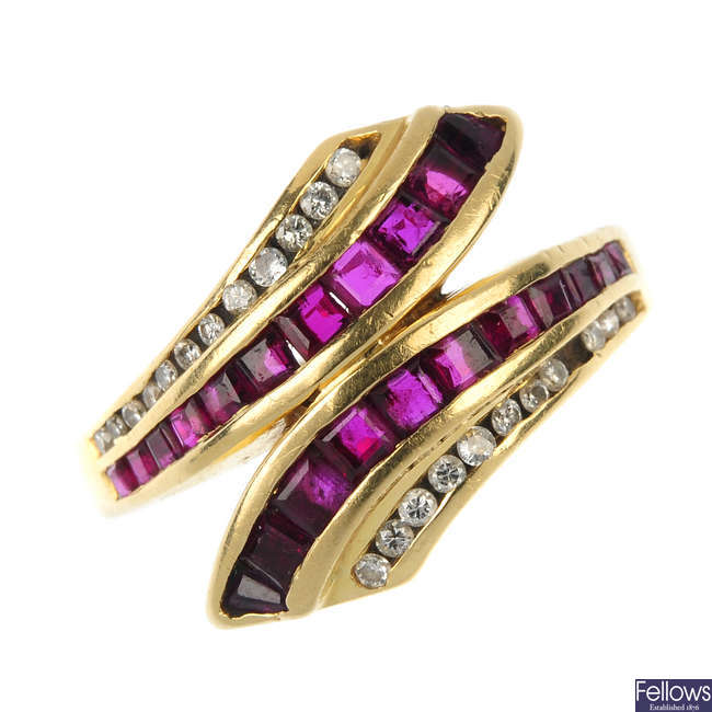 An 18ct gold ruby and diamond crossover ring.