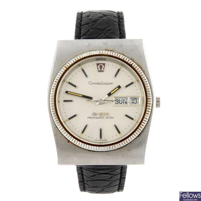 OMEGA - a gentleman's Megaquartz together with an Omega Geneve bracelet watch.