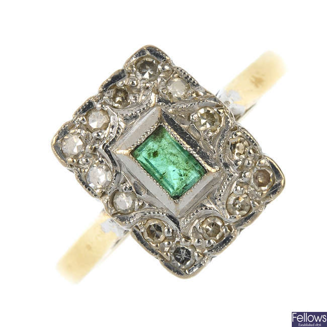 A mid 20th century 18ct gold emerald and diamond ring.