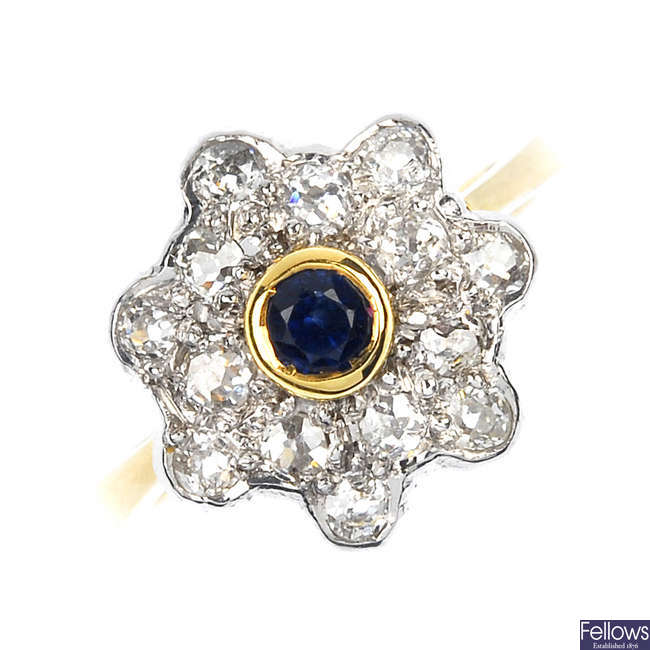 An 18ct gold sapphire and diamond floral cluster ring.
